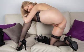 Sexy Milf strips off all her clothes added to plays with her shaved pussy