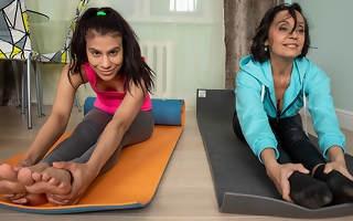 Lesbian yoga teacher seduces her young feminine student