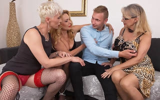 Three horny cougars share one big cock during groupsex