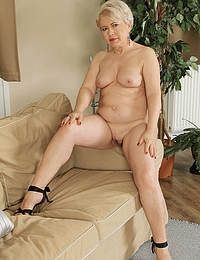 58 year old Mimi slipping off her evening dress and opening her legs