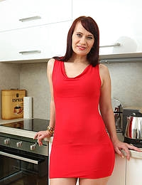 Horny long haired Vera Delight spreads her legs on the kitchen counter