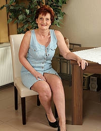 Ginger haired 53 year old Hillary G strips and spreads her old legs