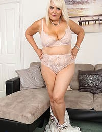 Curvy big breasted mature slut playing with herself