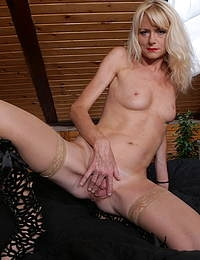 Naughty blonde MILF playing with her shaved pussy