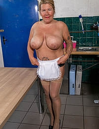 Big breasted cleaning lady playing with her dirty self in the kitchen