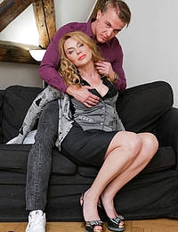 Hot MILF Mya Evans seduces her toy boy for some naughty sex on the couch