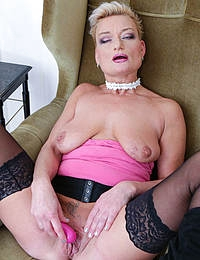 shaved mature slut playing with herself