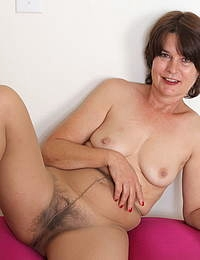 Naughty mature lady playing with her hairy pussy