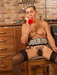Hairy housewife playing with her pussy in the kitchen