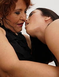 Naughty old and young lesbian couple making out