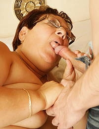 Horny mature slut playing with her toy boy