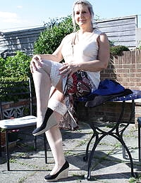 Horny mature lady strips in her garden