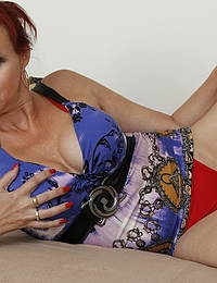 Horny red housewife playing with herself